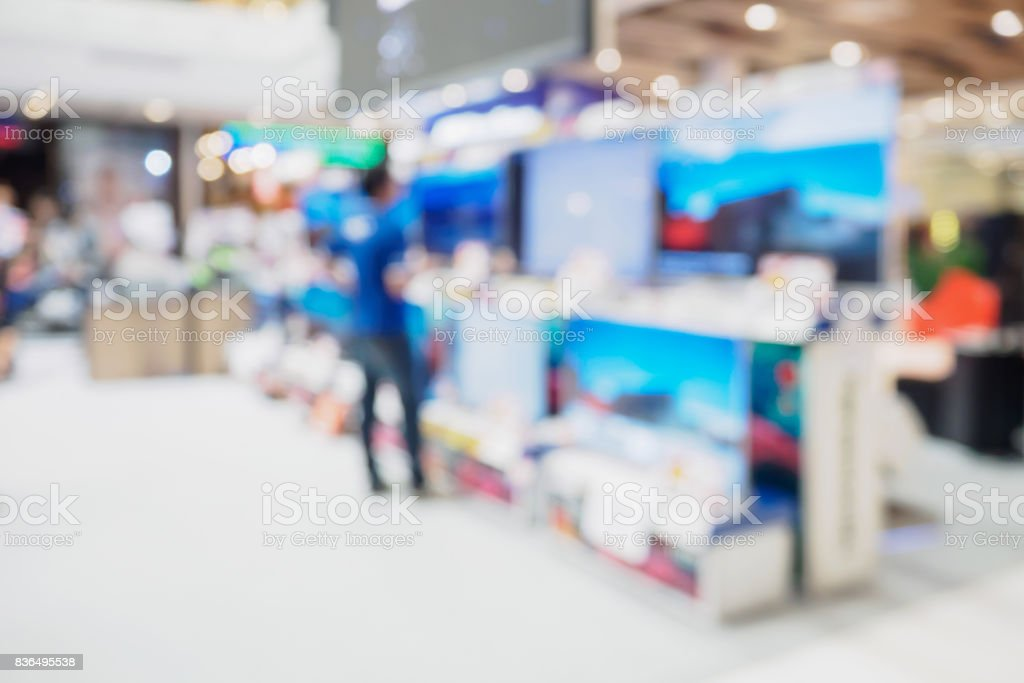 Television shelf in eletronic department store blurred background stock photo