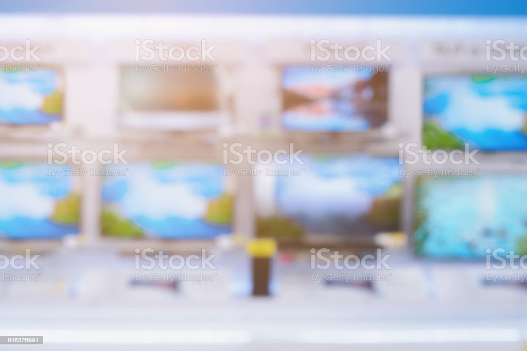 Television shelves retail shop display in Electronic Department store blurred background stock photo
