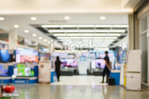 istock Television Smart TVs 4K Ultra HD display on shelves in eletronic department store blur background 881263508