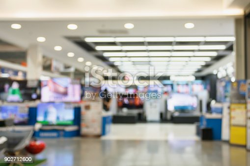 istock Television Smart TVs 4K Ultra HD display on shelves in eletronic department store blur background 902712600