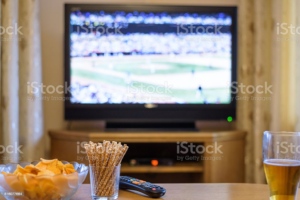 Television, TV watching (baseball match) with snacks and alcohol stock photo