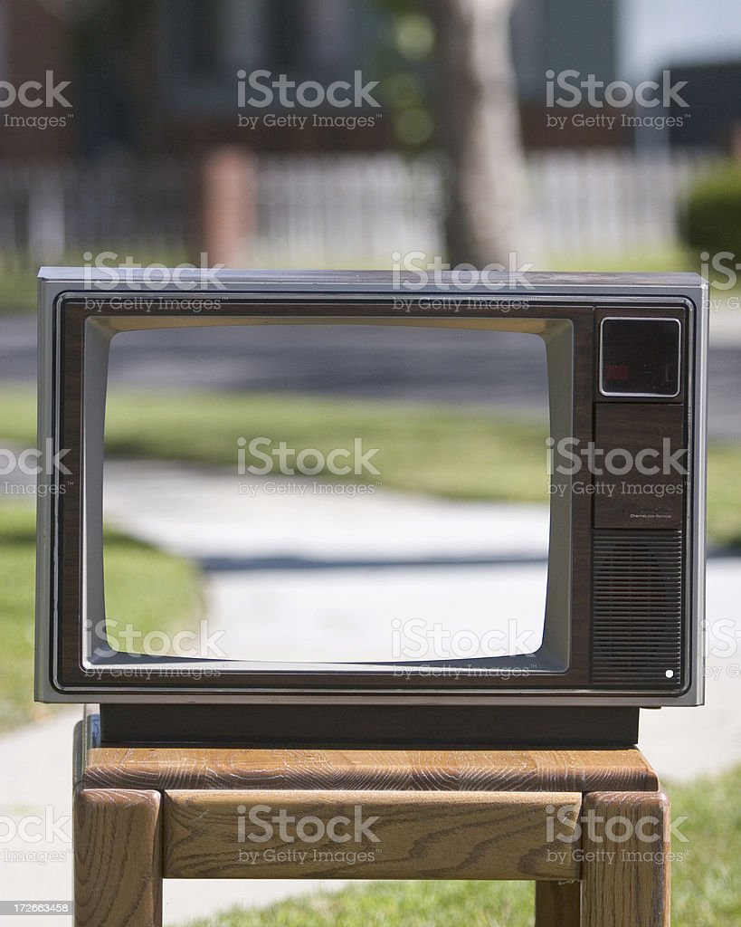 Television with blurred outdoor background royalty-free stock photo