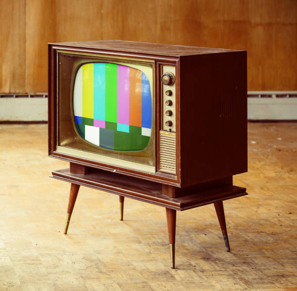 Televsion Vision Vintage television with test pattern amidst a rundown home interior. cable tv stock pictures, royalty-free photos & images