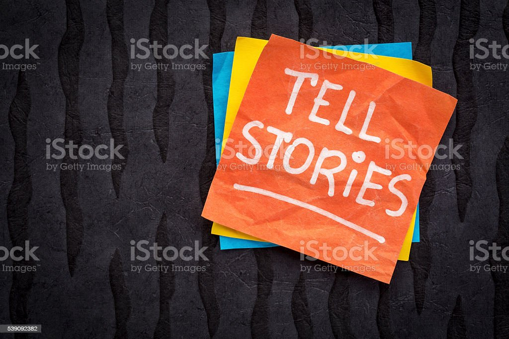 tell stories reminder note stock photo
