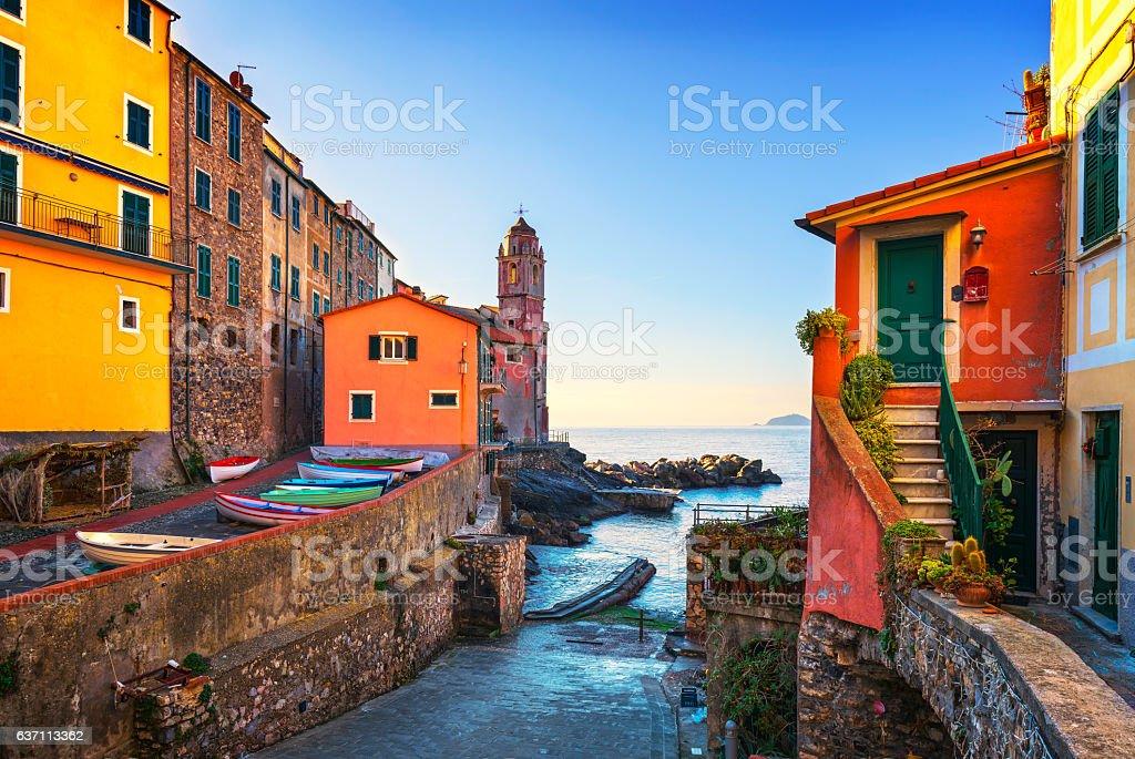 Tellaro sea village street, church and boats. Cinque terre, Ligu stock photo
