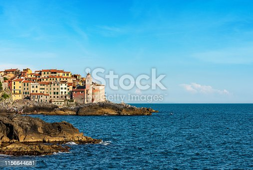 Ancient village of Tellaro and Mediterranean sea with the church of San Giorgio (St. George) in the Gulf of La Spezia, Lerici, Liguria, Italy, Europe