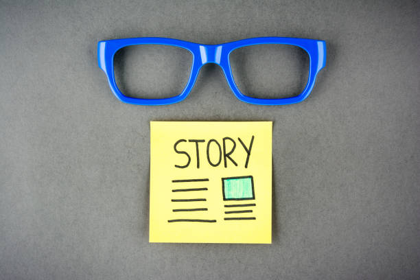Telling a story concept on dark background. Storytelling concept and eyeglasses. Telling a story concept on dark background. Storytelling concept and eyeglasses. visual content stock pictures, royalty-free photos & images