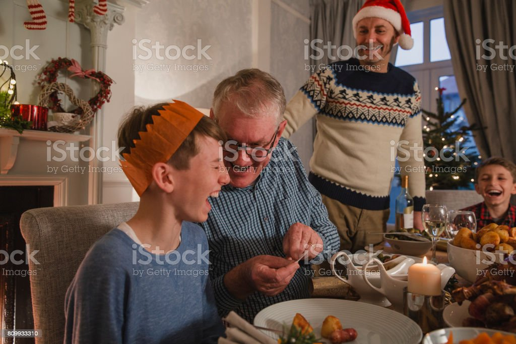 Telling Christmas Cracker Jokes stock photo