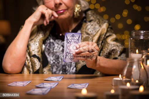 istock Telling fortune from tarot cards 505944334