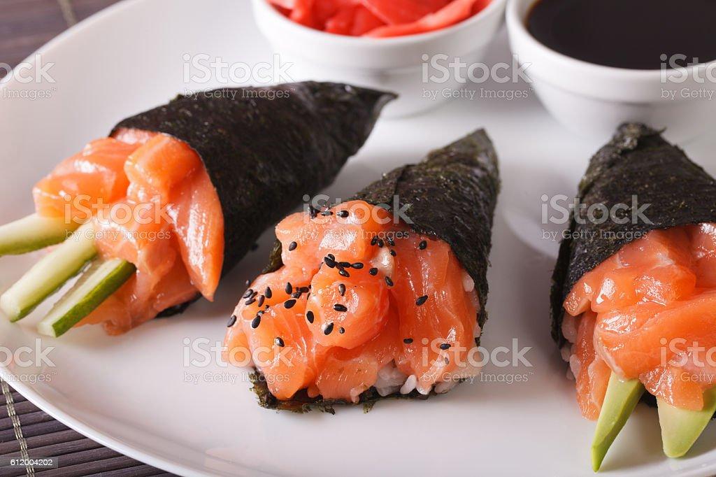 Temaki salmon on a plate close-up. horizontal stock photo