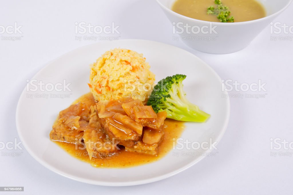 Tempeh on leek with pear purée on a white stock photo