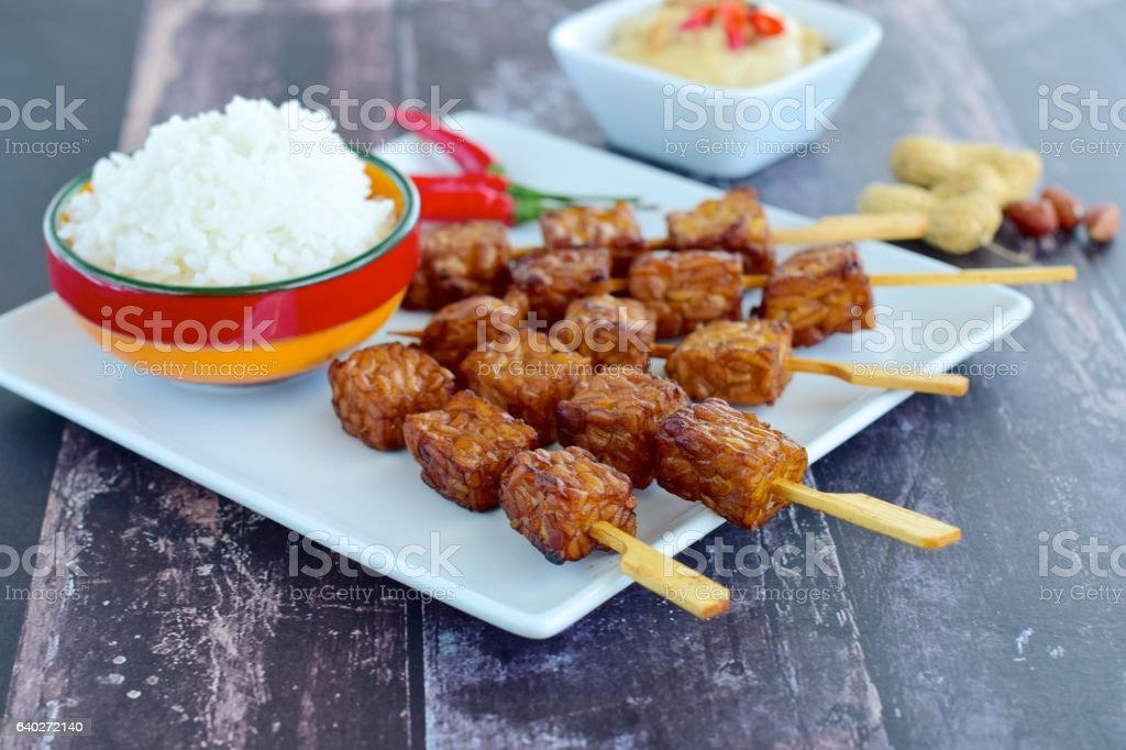 Tempeh skewers with steamed rice stock photo