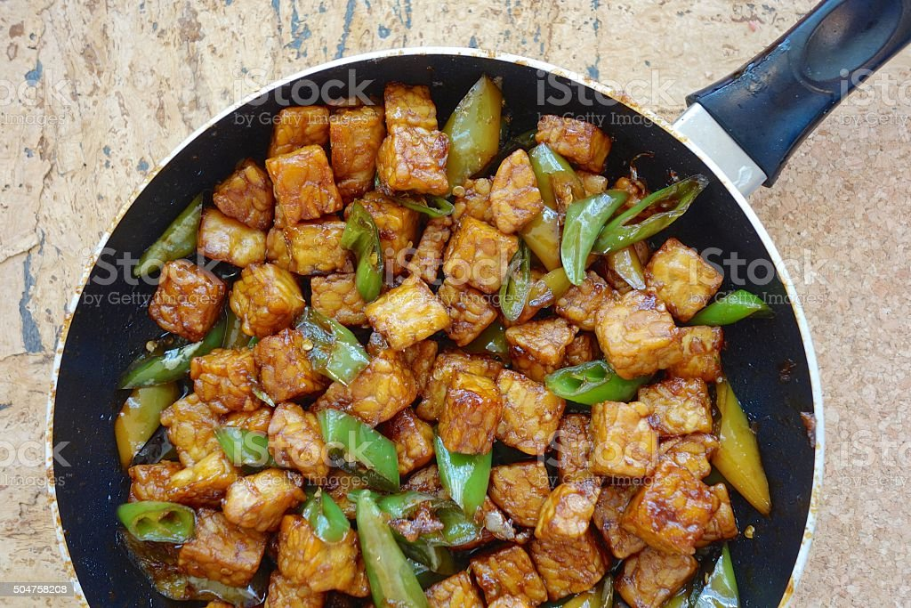 Tempeh soy sauce with green chili stock photo