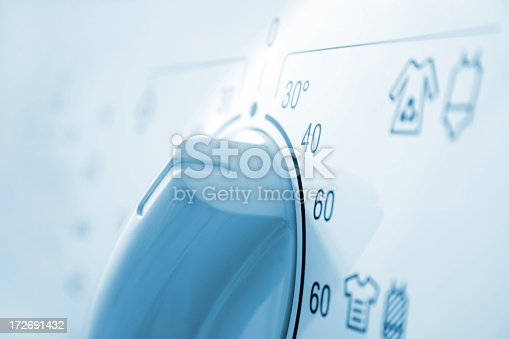 Temperature knob in the washing machine.
