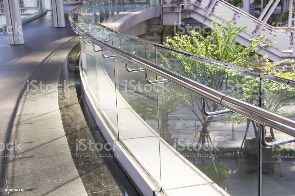 tempered glass of walk way balcony with stainless steel handrail. stock photo