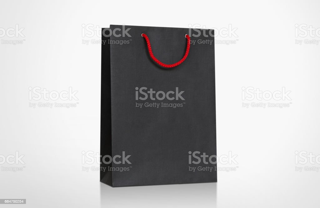 Template of Black Paper Bag with handle rope, Isolated on white background Mock-Up stock photo