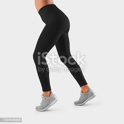 Template of black tight-fitting sweatpants on the taut legs of a girl, running, side view. Mockup of fitness leggings for presentation of design, pattern and advertising in the online store