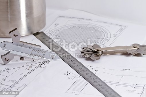 istock Templates for visual measurement control are on the drawing pipe 494151602