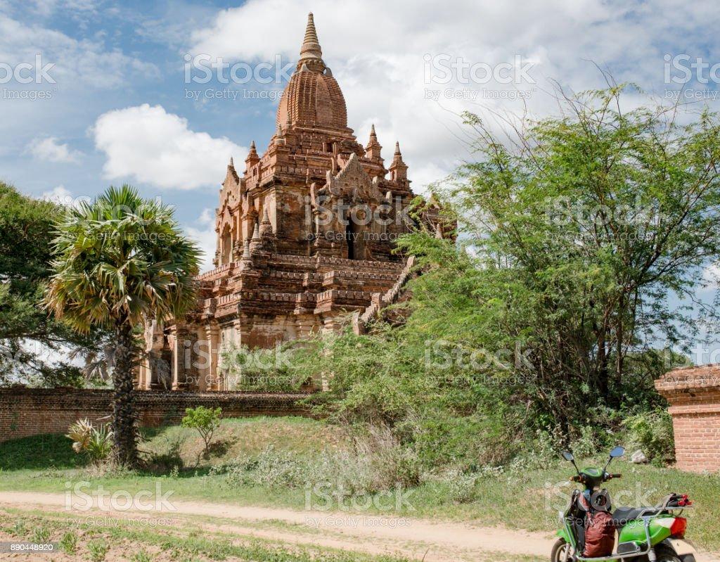 Temple and motorbike in Bagan Myanmar stock photo