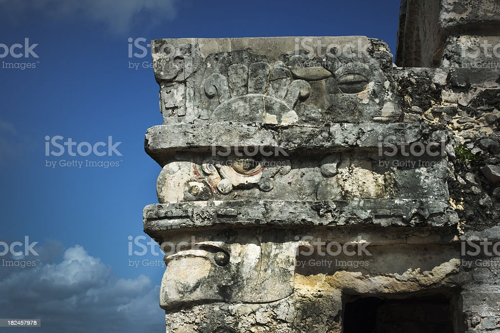 Temple Corner Stone Carved Face of Mayan Culture, Tulum, Mexico royalty-free stock photo