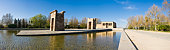 The stone arches of the ancient Egyptian Templo de Debod reflecting in the still waters of the Parque del Oeste, Madrid, Spain. Adobe RGB 1998 color profile