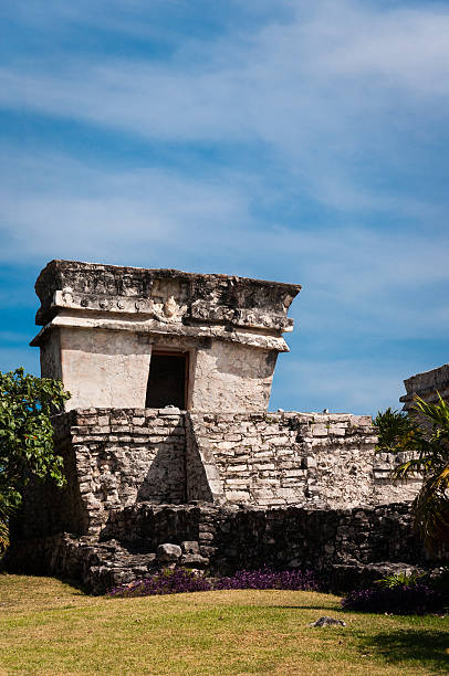 Temple from Mayan ruins in Tulum Mexico Yucatan One of the well preserved Mayan sites in Tulum, Mexico on Yucatan Peninsula. Part of the precolumbian Maya walled city, which served as a mayor port. naya rivera stock pictures, royalty-free photos & images