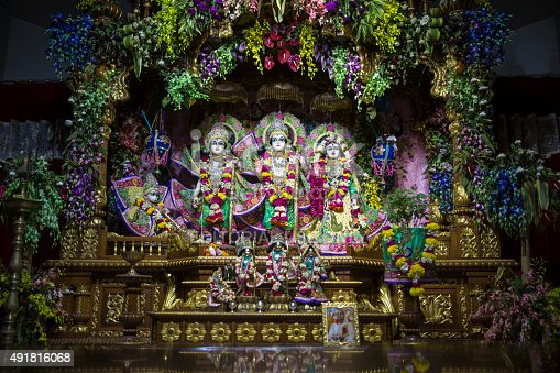 New Delhi, India - September 10, 2015 : Idols of Lord Rama, Laxman and Sita along with Hanuman at ISKCON Temple, New Delhi. Idol worship is highly prevalent in this part of the world. The idols are bathed every day and adorned with ornate dress and decorated with flowers every day.