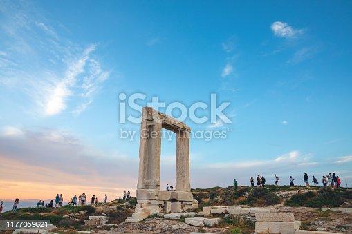 Tourists at temple of Apollo - Portara (Naxos island, Greece).
