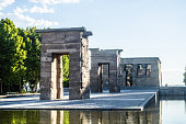 Madrid, Spain - July 29, 2015: The ancient Egyptian stone pylons of the Temple of Debod, in the Parque del Oeste at the heart of Madrid, Spain's vibrant capital city. It was built in the 4th century BC. Is a popular tourism destinations. A few tourists are in the view.