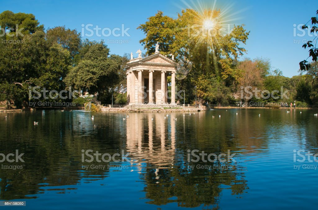 Temple of Esculapio at sunrise located at the beautiful garden of Villa Borghese, Rome royalty-free stock photo
