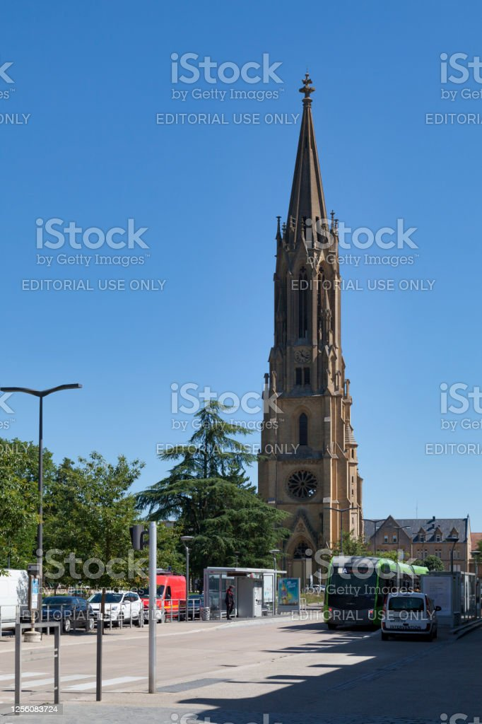 "Temple of Garnison in Metz Metz, France - June 24 2020: The Temple of Garnison is a building of worship located square of Luxembourg. It is one of the tallest monuments in the city, its bell tower measuring almost a hundred meters.""n Architecture Stock Photo"