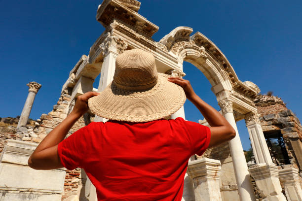 Temple of Hadrian - Ephesus Young Woman Visiting Ephesus Ancient City. Izmir, Turkey. celsus library stock pictures, royalty-free photos & images