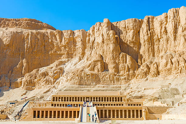 Temple of Hatshepsut Luxor, Egypt - January 15, 2015: Tourists visiting the temple of Hatshepsut in Egypt near The Valley Of The Kings valley of the kings stock pictures, royalty-free photos & images