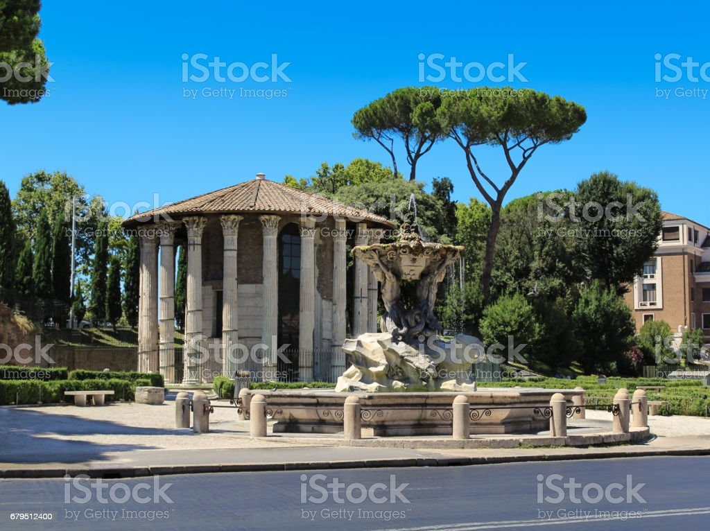 Temple of Hercules Victor (Tempio di Ercole Vincitore) and Fountain of the Tritons in Forum Boarium, Piazza Bocca della Verita, Rome, Italy. stock photo
