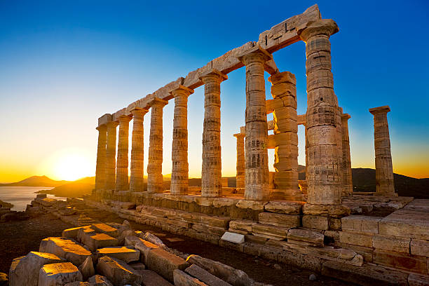 Temple of Poseidon at Cape Sounion, Greece Greece. Cape Sounion - Ruins of an ancient Greek temple of Poseidon before sunset ancient greece stock pictures, royalty-free photos & images