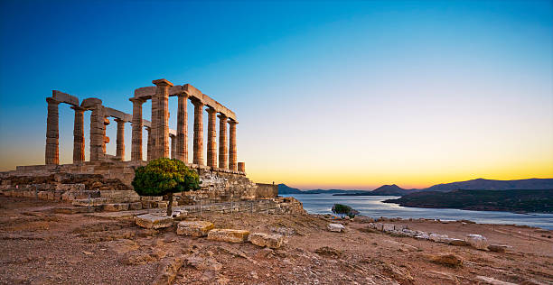 Temple of Poseidon at Cape Sounion, Greece Greece. Cape Sounion - Ruins of an ancient Greek temple of Poseidon after sunset ancient greece stock pictures, royalty-free photos & images
