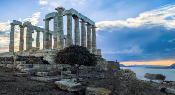Temple of poseidon at sunset stock photo