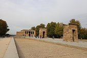 Temple of the Debod in Madrid, Spain, October 12, 2019. \nit is an ancient Egyptian temple that was dismantled and rebuilt in Madrid, Spain.\nthere are many tourists in this photo.