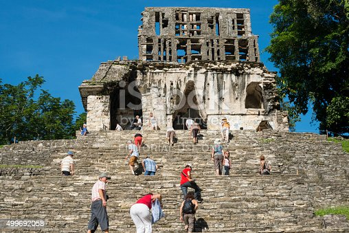 Palenque, Mexico - November 24, 2014: Visitors clamber up the Templo del Sol in Palenque, Mexico. The Mayan city flourished in the 7th century.