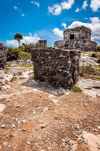 Temple on one of the Mayan ruins, Tulum, Mexico, Yucatan One of the well preserved Mayan sites in Tulum, Mexico on Yucatan Peninsula. Part of the precolumbian Maya walled city, which served as a mayor port. naya rivera stock pictures, royalty-free photos & images