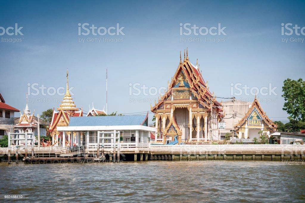 Temples Next To The Chao Phraya River In Bangkok, Thailand stock photo