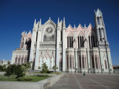 Photo of the templo expiatorio church in leon guanajuato mexico.  This catholic church dates from the 19th century and features beautiful gothic architecture.  Pictured here is the church and large courtyard.