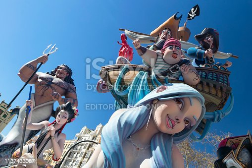 Valencia, Spain - March 14, 2019: Temporary colorful sculptures during the Las Fallas days. The Fallas is a traditional celebration held in commemoration of Saint Joseph in the Valencia city. This monuments are burnt during the celebration.