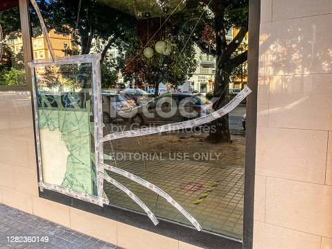 Valencia, Spain - October 26, 2020: Wood piece used to cover hole in broken window and prevent it from tearing apart. This temporary fix is necessary until the replacement with a new glass