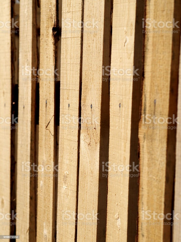 temporary wooden fence made from raw boards stock photo
