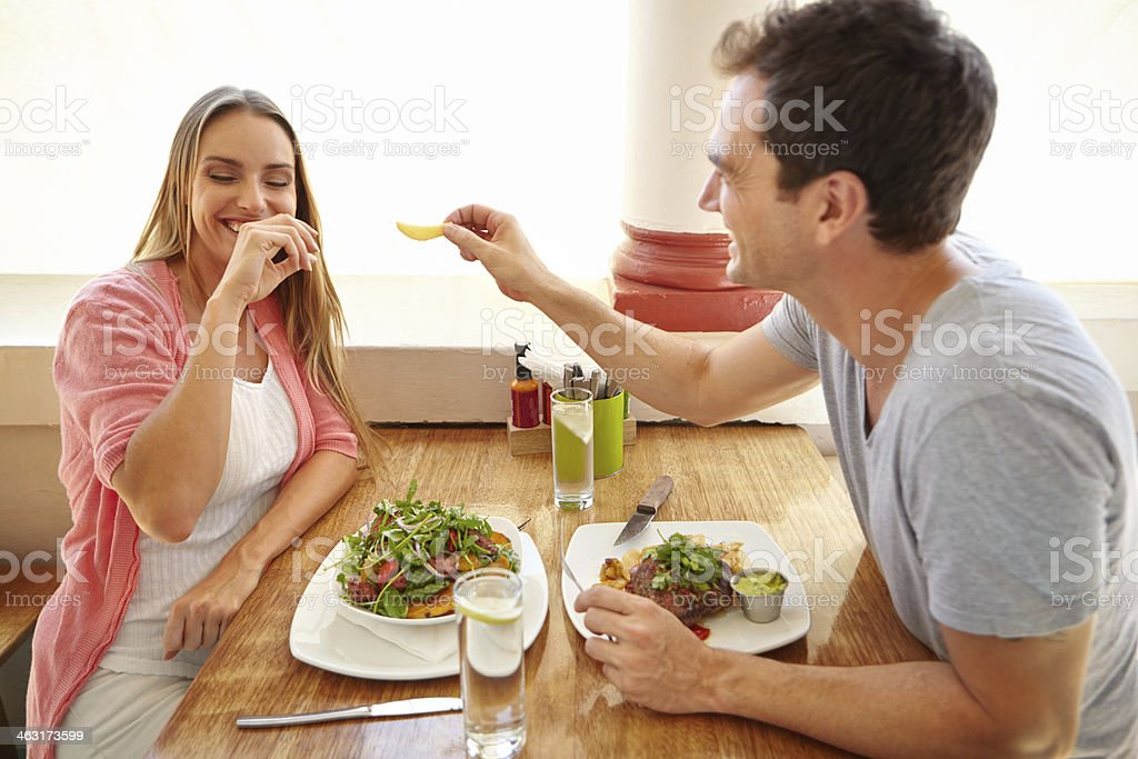 Tempting her with a chip stock photo