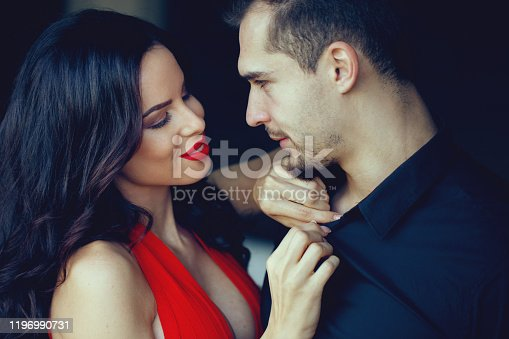 Tempting milf woman in red undress sexy young man shirt, cinematic style