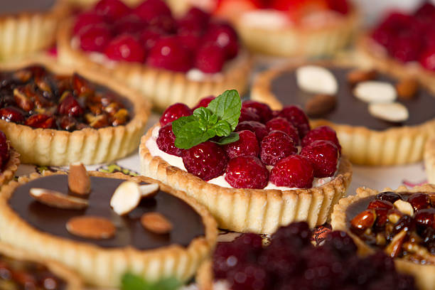 Tempting pastries and pies Variety of french pastries and pies pastry dough stock pictures, royalty-free photos & images