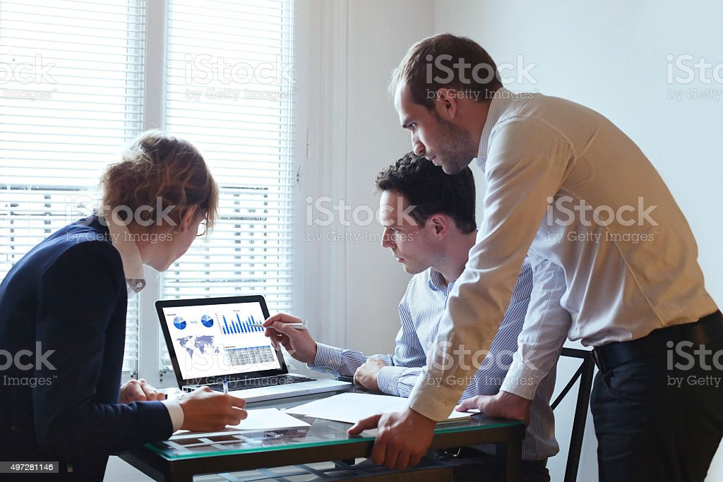 temwork, business team with laptop in the office, people working stock photo