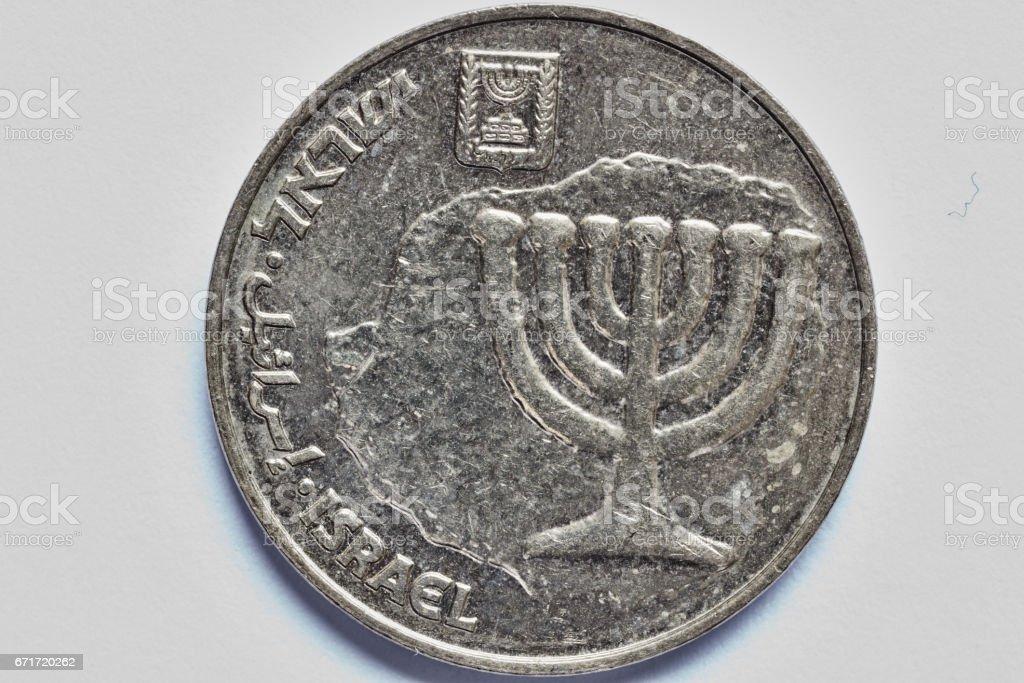 Ten agorot coin macro isolated on white surface stock photo
